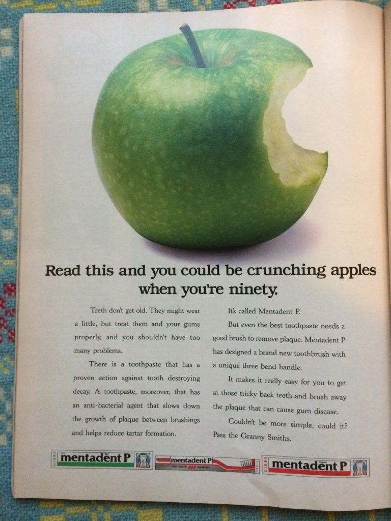 "Vintage 1980s magazine advert for Mentadent P Toothpaste headlined ""Read this and you could be crunching apples when you're ninety."""