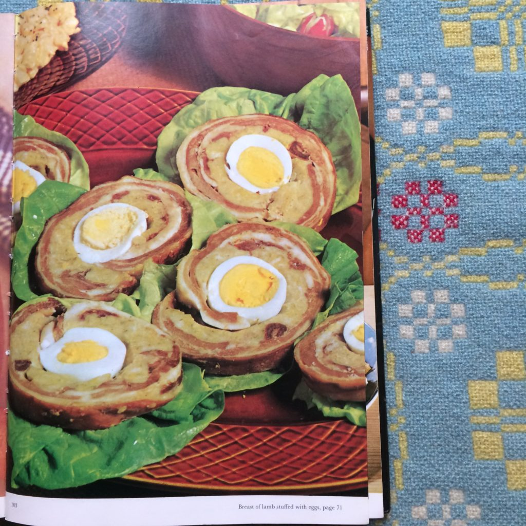 Photo from vintage cookbook of lamb breast stuffed with stuffing and eggs and cut into slices.