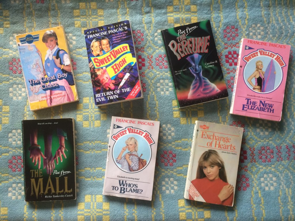 Seven books on a blanket. Two Sweet Dreams novels, three Sweet Valley High and two Point Horror.