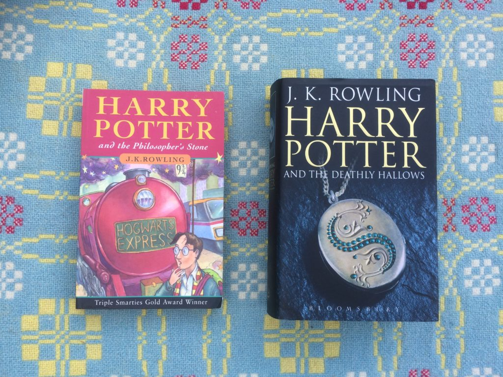 The First and Last Harry Potter Books by J.K. Rowling. First is paperback, last is hardback.