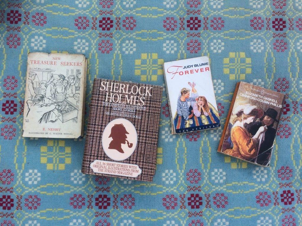 Four books by E. Nesbit, Arthur Conan Doyle, Judy Blume and Elizabeth Gaskell