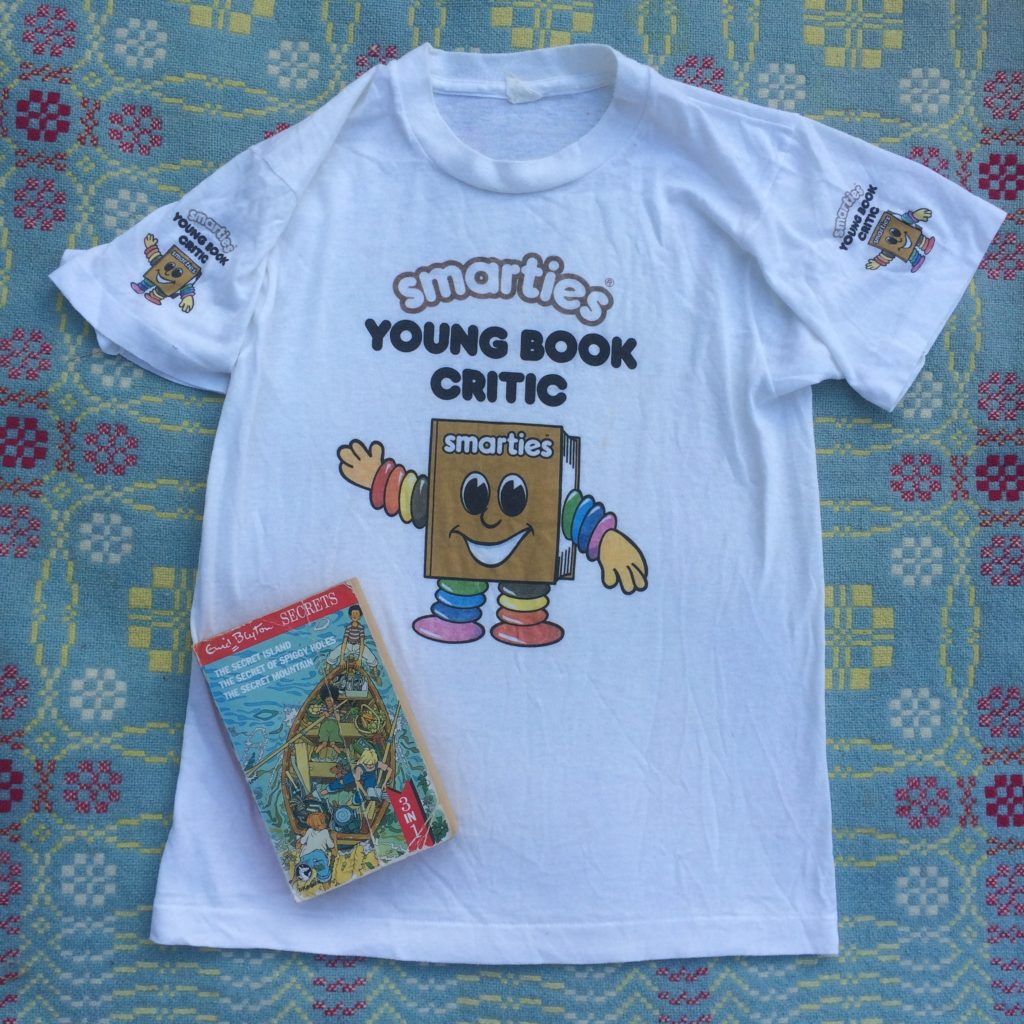 """Child's T Shirt with """"Smarties Young Book Critic"""" printed on it. Copy of Enid Blyton's Secret Island"""