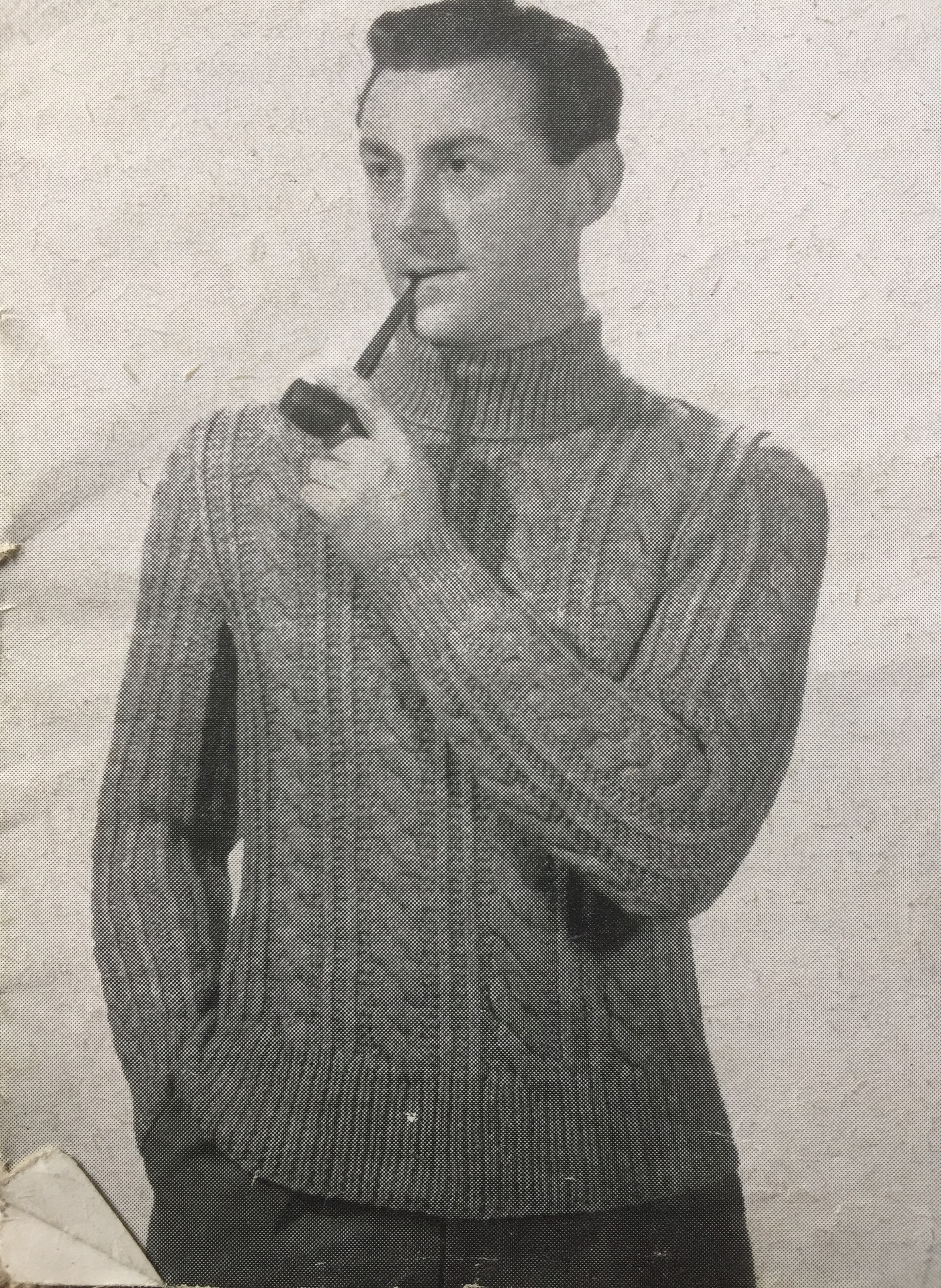 Vintage photo of male model with pipe