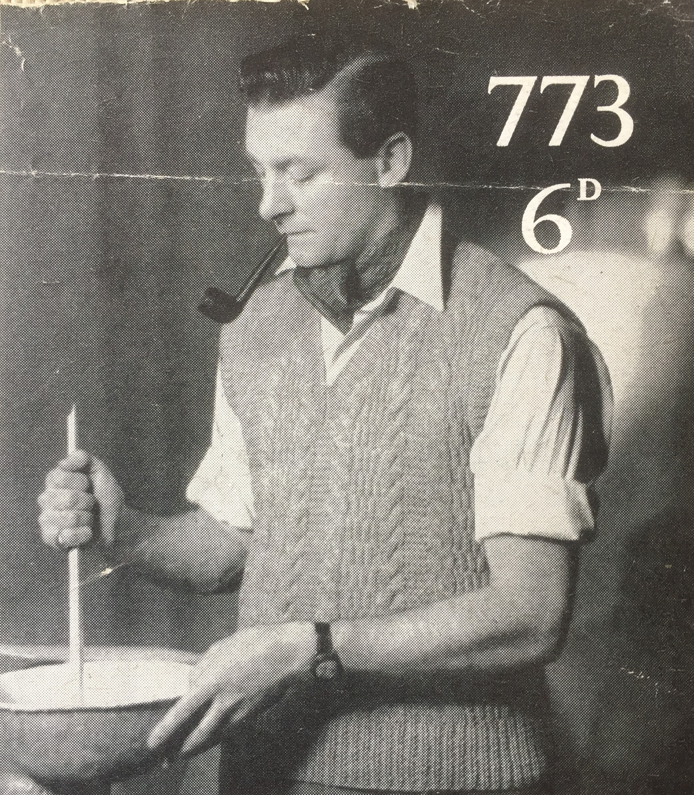 vintage photo of male knitwear model stirring something unidentified in a shed
