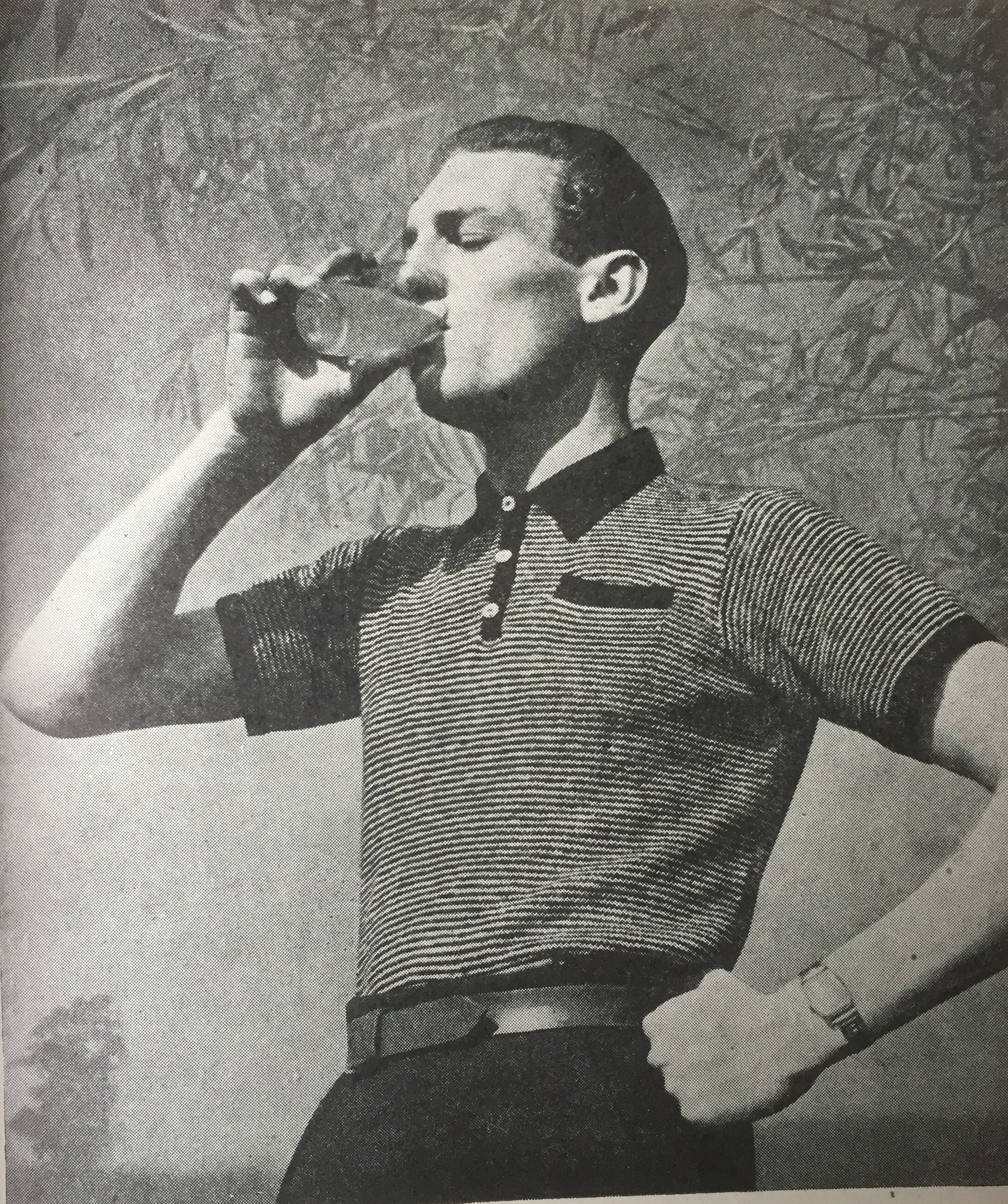 Vintage photo of male sweater model drinking a glass of squash