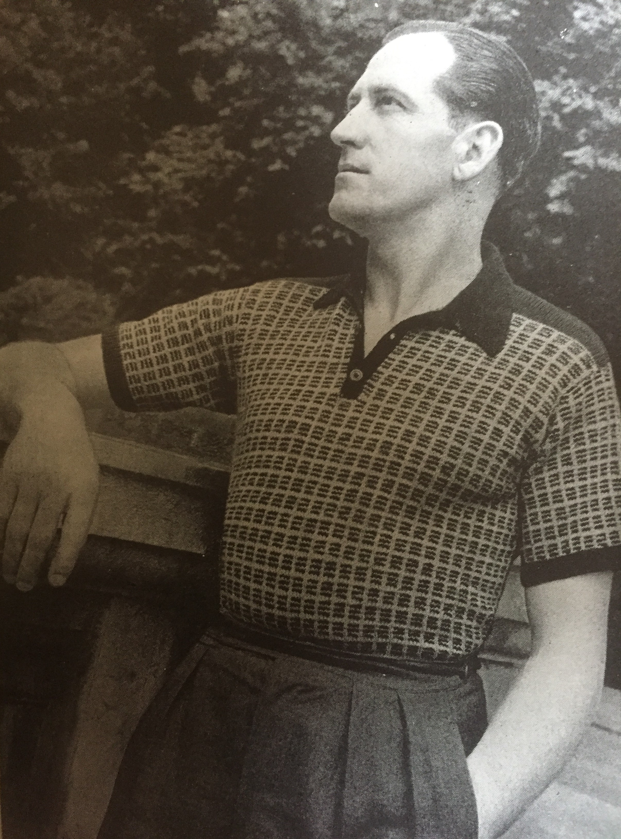 Vintage photo of male knitting pattern model staring into the distance