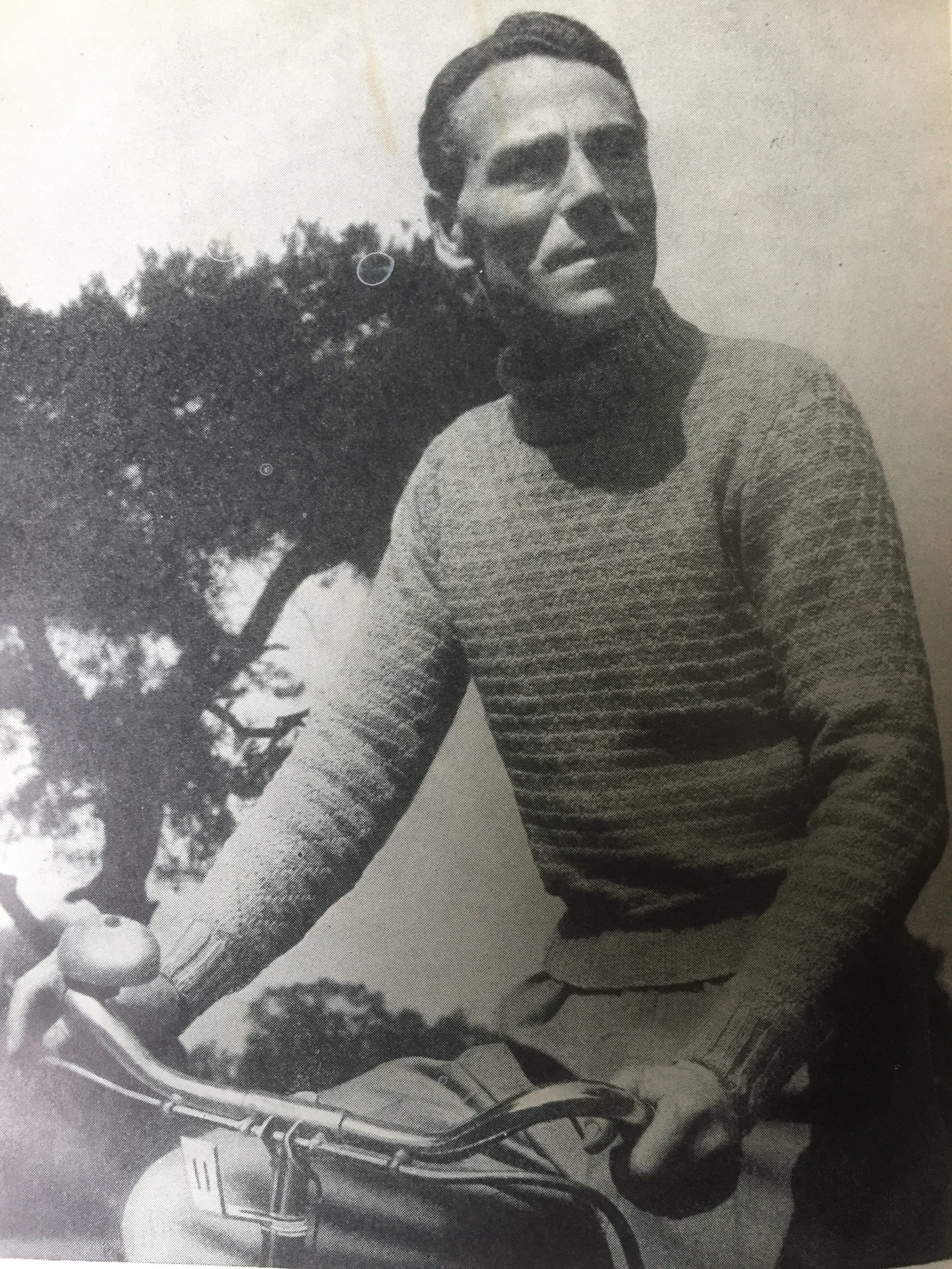 vintage photo of male knitwear model cycling